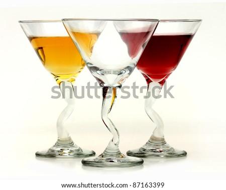 Three elegant crystal cocktail glasses isolated on white background - stock photo