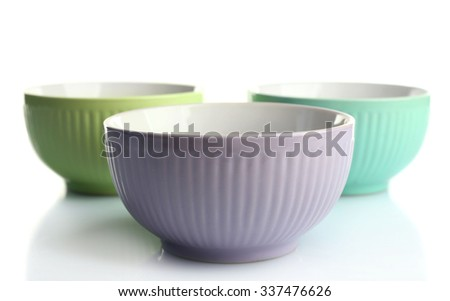Three empty ceramic bowls, isolated on white - stock photo