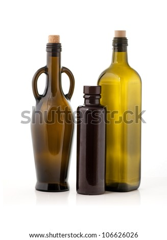 Three empty glass oil bottles