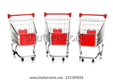 three empty shopping carts, isolated on white - stock photo