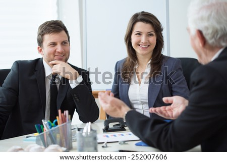 Three entrepreneurs during business conversation - stock photo