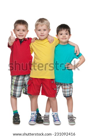 Three fashion little boys stand together against the white background - stock photo