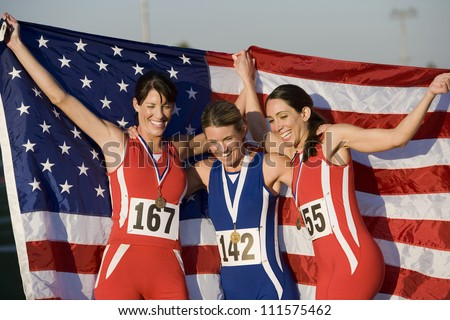 Three female Caucasian athletes with American flag and medals