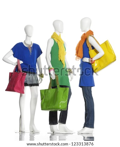 Three female clothing in jeans with scarf, bag on mannequin - stock photo