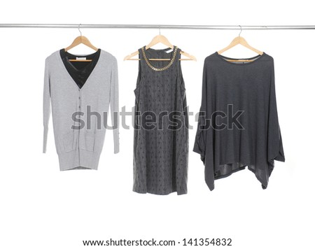 Three female dress isolated on hanging - stock photo