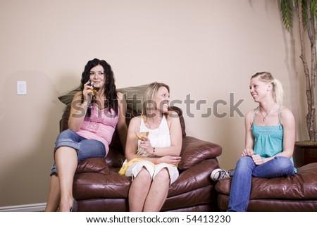 Three Females Socializing at Home - stock photo