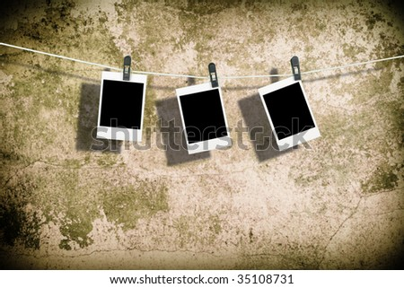 Three film blanks on a rope - stock photo