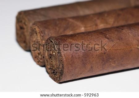 three fine hand made cigars - stock photo