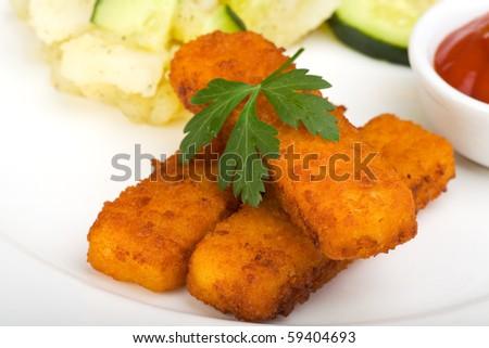 three fish fingers and potato salad - stock photo