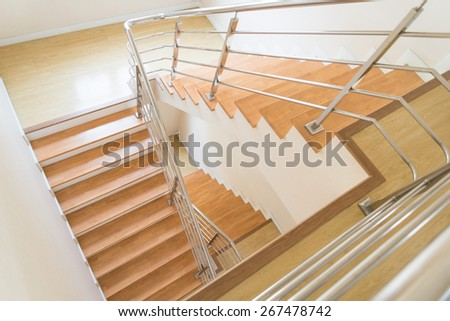 Three floor with wooden stairs modern design. - stock photo