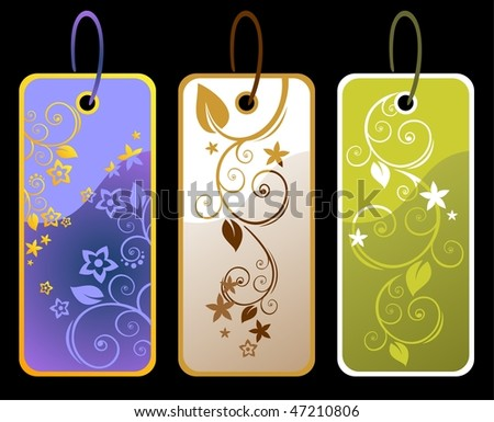 Three floral price tags isolated on a black background.