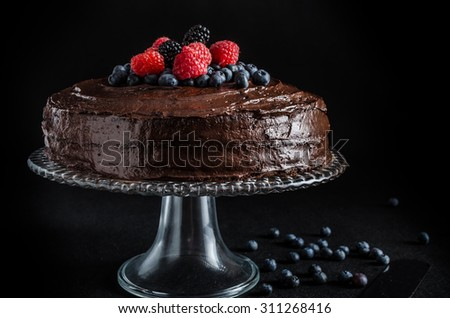 Three flour chocolate cake with, without berries - stock photo
