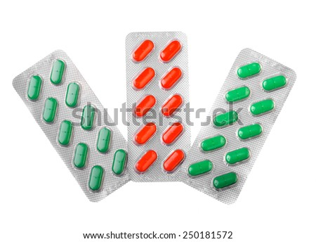 Three foil blisters of pills isolated over white background - stock photo