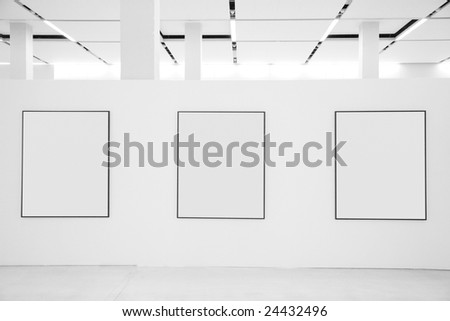 Three frames in showroom - stock photo