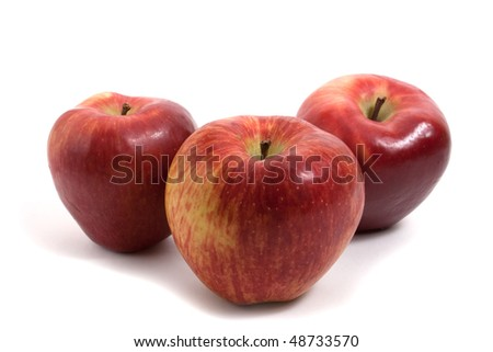 three fresh apples in a row isolated on white background