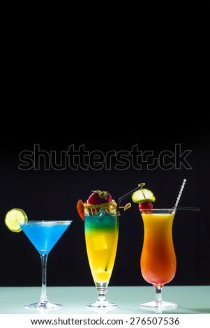 Three fresh cocktail over dark background - stock photo