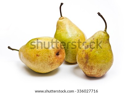Three fresh green pears. Group of juicy ripe fruits. View of conference pear isolated on white background.