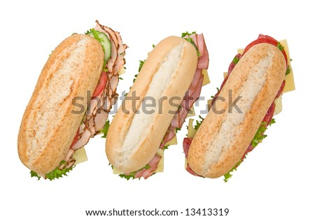 Three fresh sandwiches isolated on white background: salami, turkey and ham - stock photo