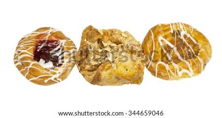 Three freshly baked Danish pastries - stock photo