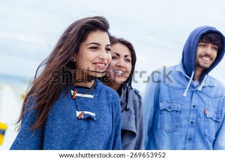 Three friends having fun outdoors - stock photo