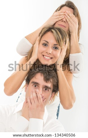 Three friends mimicking see no evil, hear no evil, speak no evil - stock photo