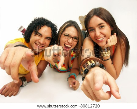 Three friends sharing and smiling on white background. - stock photo