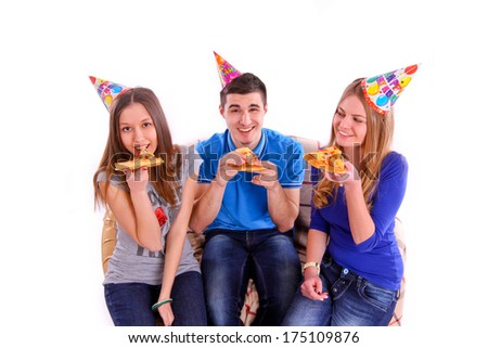 Three friends sitting on a sofa and eating pizza isolated - stock photo