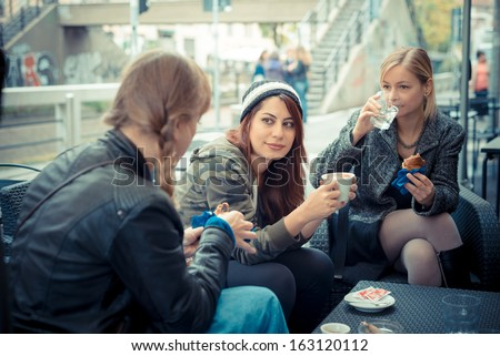 three friends woman at the bar in urban contest - stock photo