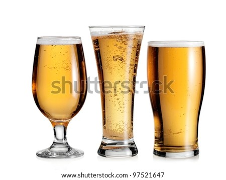 Three full glasses with beer - stock photo