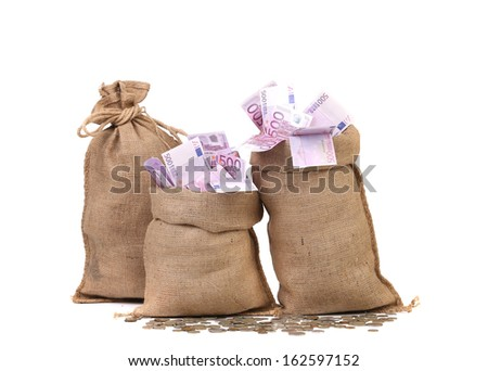 Three full sacks of euro bills. Isolated on a white background. - stock photo