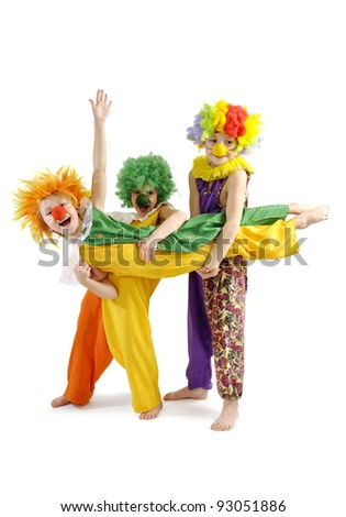 Three funny clowns in colorful wigs - stock photo