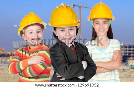 Three future workers with a building construction of background - stock photo