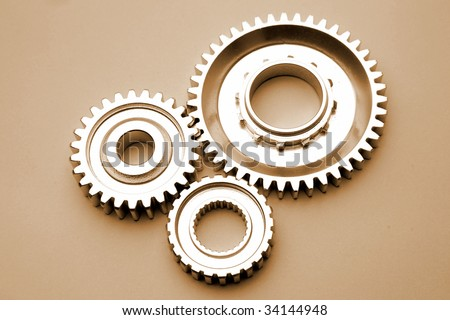 Three gears meshing together - stock photo