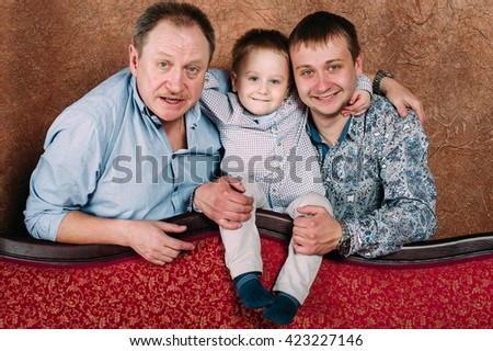 Three Generation Family Sitting On Sofa Together. Classic portrait - stock photo