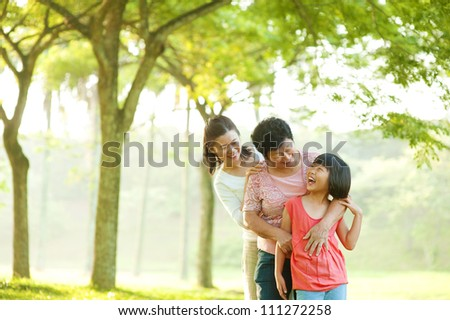 Three generations family having fun at outdoor
