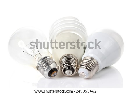 Three generations of light bulbs.  incandescent, energy saving fluorescent and LED isolated on white background - stock photo