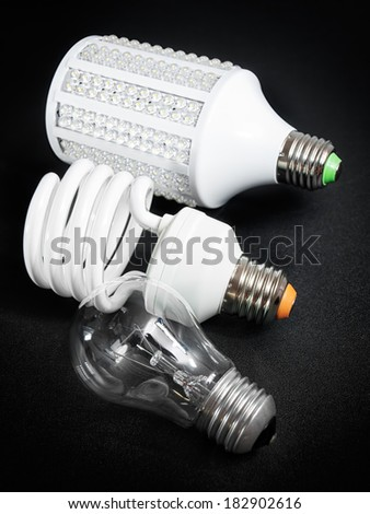Three generations of light bulbs that are on the market in recent years. - stock photo