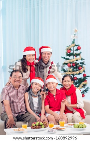 Three generations of one family gathering to celebrate Christmas - stock photo