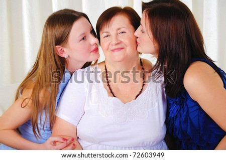three generations of women together - mother, daughter and grandmother - stock photo