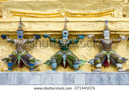 Three giants. Temple Guardian. Three Statues of Giant Guardians in front of the golden pagoda. Wat Phra Kaew, Temple of the Emerald Buddha  is famous temple in Bangkok, Thailand
