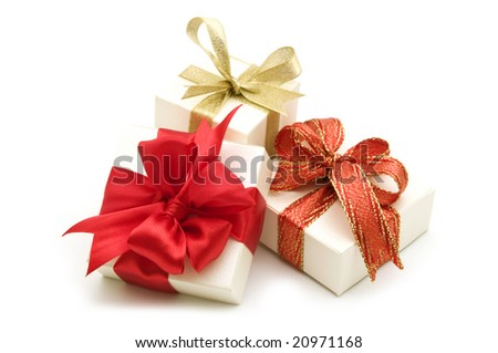 three gift boxes with red ribbon bow