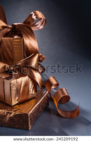 three giftboxes on black background with copyspace