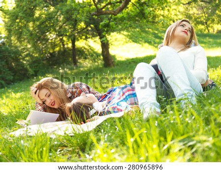 Three girlfriends relaxing in the park