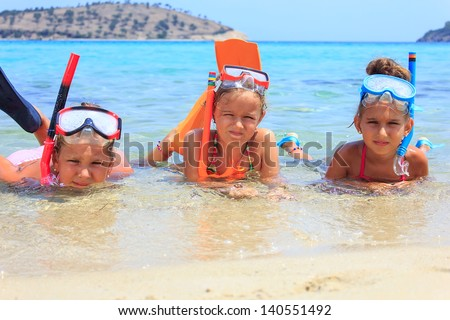 Three girls in the tropical sea - stock photo