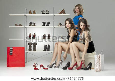 three girls looking happy high heels shoes case - stock photo