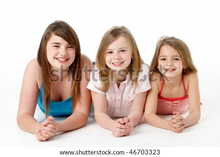 Three Girls Piled Up In Pyramid In Studio