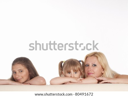 three girls posing on a white background - stock photo