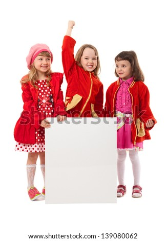 Three girls wear red clothes. They hold white billboard. It's isolated on white background. - stock photo