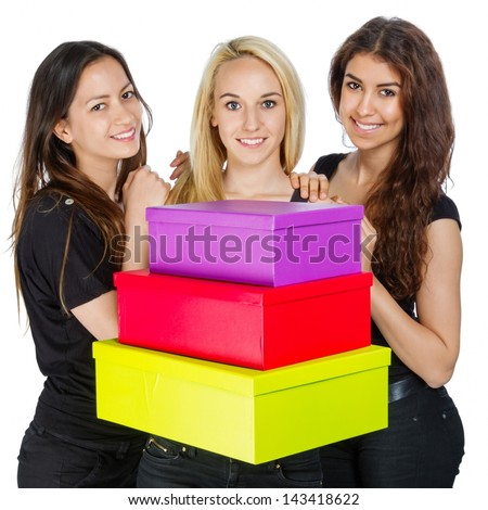 Three Girls with colorful boxes on white background - stock photo