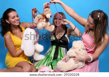 Three girls with toys